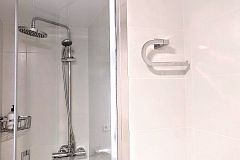 large shower cabin with rain effect head and handheld device will make you not want to leave for hours.