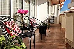 go out to the terrace and enjoy the warm embrace of the sun at the Gatsby apartment with sunny terrace for rent for months in Barcelona Les Corts close to Diagonal avenue