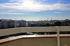 city view from the terrace of the Gatsby apartment in Barcelona for monthly rental, just a stroll away from the financial distric of Barcelona
