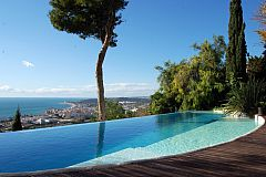 amazing swiming pool and teka deck in this luxury rental in Barcelona Sitges