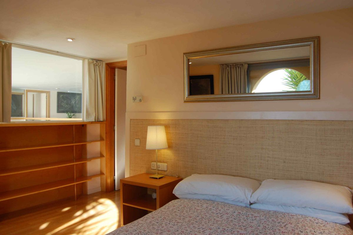 bedroom with working space in this luxury rental in Barcelona Sitges