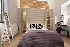 bedroom at the Gothic quarter historical center with private courtyard - Catedral apartment for rent in Barcelona corporate apartments for monthly rentals