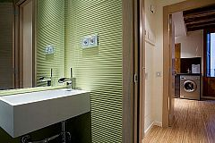 bathroom modern sink and green lime tiles