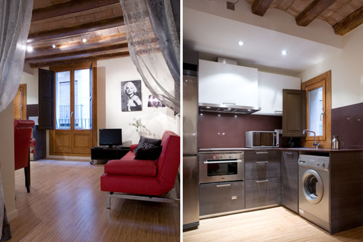 living area and modern kitchen with stainless steel appliances at the Bella II furnished apartment in Barcelona on La Rambla for monthly rentals in Barcelona